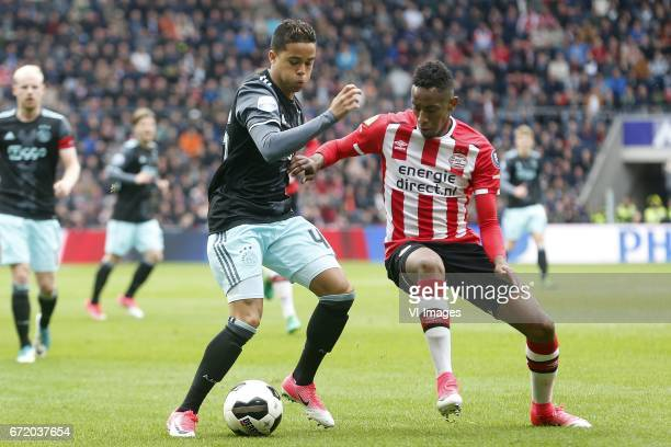 Justin Kluivert of Ajax Joshua Brenet of PSVduring the Dutch Eredivisie match between PSV Eindhoven and Ajax Amsterdam at the Phillips stadium on...