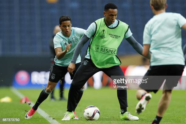 Justin Kluivert of Ajax Kenny Tete of Ajax Frenkie de Jong of Ajaxduring a training session prior to the UEFA Europa League final match between Ajax...