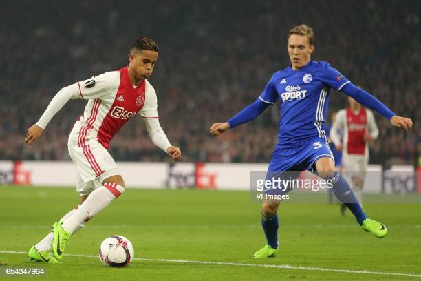 Justin Kluivert of Ajax Ludwig Augustinsson of FC Kopenhagenduring the UEFA Europa League round of 32 match between Ajax Amsterdam and FC Copenhagen...