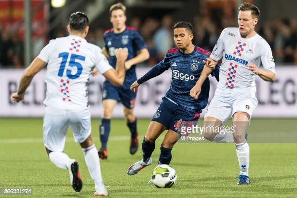 Justin Kluivert of Ajax Maarten Woudenberg od ASV De Dijk during the Second Round Dutch Cup match between De Dijk and Ajax Amsterdam at Kras stadium...