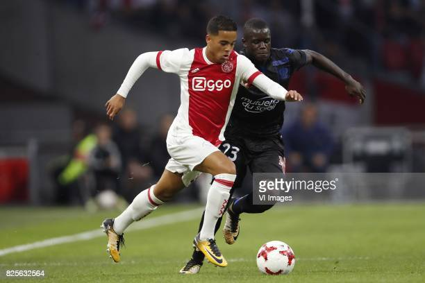 Justin Kluivert of Ajax Malang Sarr of OCG Nice during the UEFA Champions League third round qualifying first leg match between Ajax Amsterdam and...