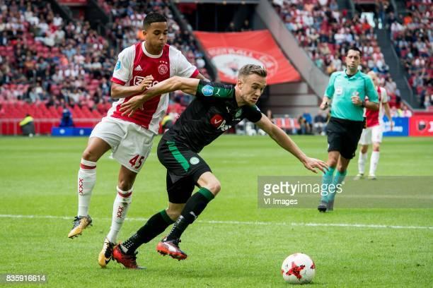 Justin Kluivert of Ajax Mike te Wierik of FC Groningen during the Dutch Eredivisie match between Ajax Amsterdam and FC Groningen at the Amsterdam...