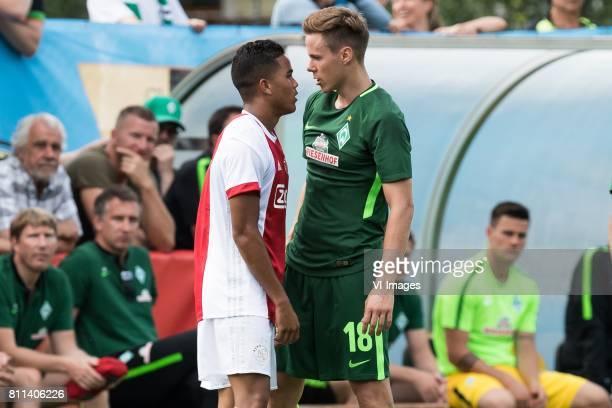 Justin Kluivert of Ajax Niklas Moisander of SV Werder Bremen during the friendly match between Ajax Amsterdam and SV Werder Bremen at Lindenstadion...