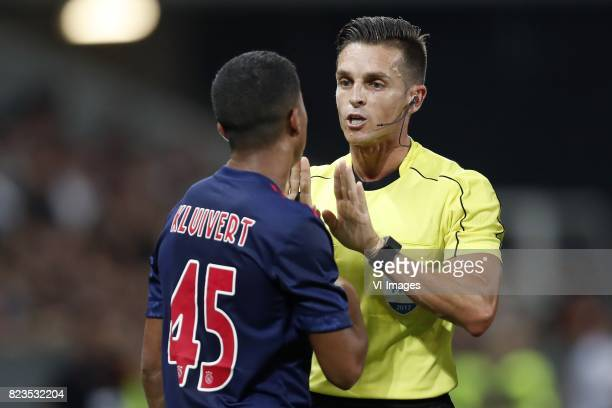 Justin Kluivert of Ajax referee Carlos Del Cerro during the UEFA Champions League third round qualifying first leg match between OGC Nice and Ajax...