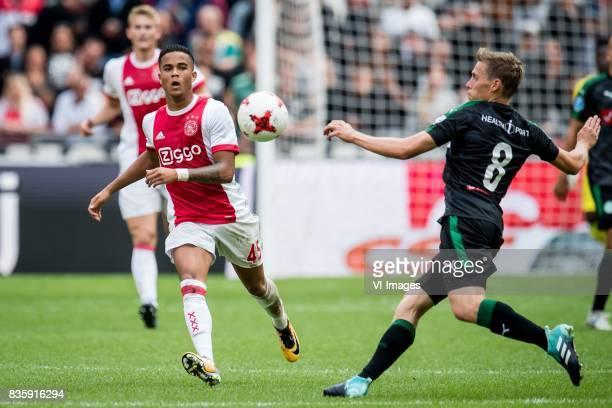 Justin Kluivert of Ajax Ruben Yttergard Jenssen of FC Groningen during the Dutch Eredivisie match between Ajax Amsterdam and FC Groningen at the...