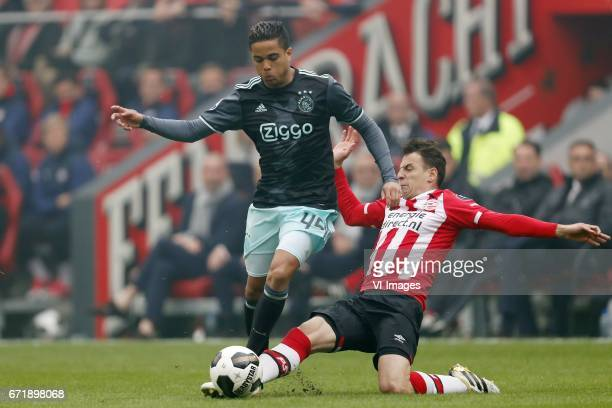 Justin Kluivert of Ajax Santiago Arias of PSVduring the Dutch Eredivisie match between PSV Eindhoven and Ajax Amsterdam at the Phillips stadium on...