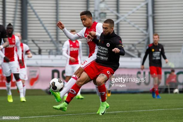 Justin Kluivert of Ajax Stanley Elbers of Excelsiorduring the Dutch Eredivisie match between sbv Excelsior Rotterdam and Ajax Amsterdam at...