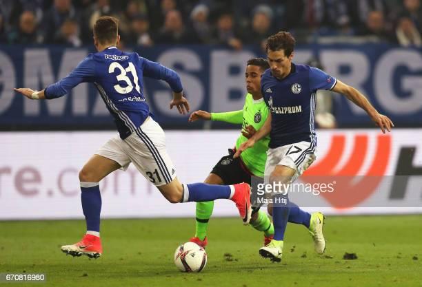 Justin Kluivert of Ajax takes on Matija Nastasic and Benjamin Stambouli of FC Schalke 04 during the UEFA Europa League quarter final second leg match...
