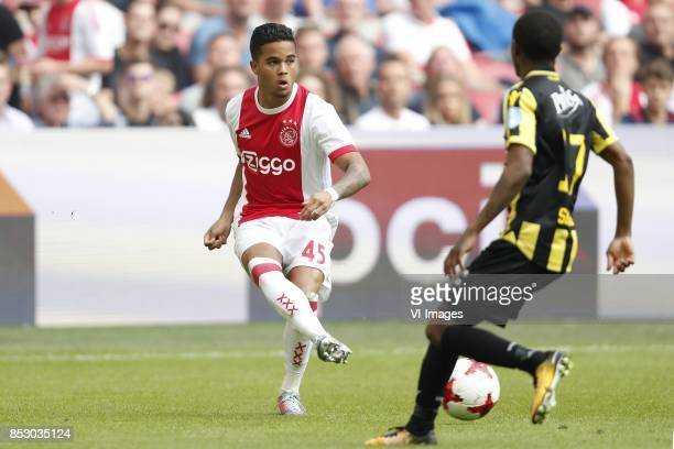 Justin Kluivert of Ajax Thulani Serero of Vitesse during the Dutch Eredivisie match between Ajax Amsterdam and Vitesse Arnhem at the Amsterdam Arena...