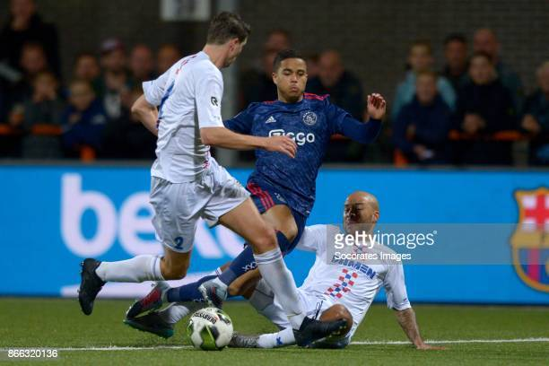 Justin Kluivert of Ajax Tony Tol of ASV De Dijk during the Dutch KNVB Beker match between De Dijk and Ajax Amsterdam at Sportpark Schellingwoude on...