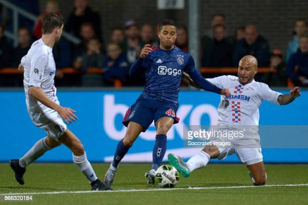 Justin Kluivert of Ajax Tony Tol of ASV De Dijk during the Dutch KNVB Beker match between De Dijk v Ajax at the Kras Stadium on October 25 2017 in...