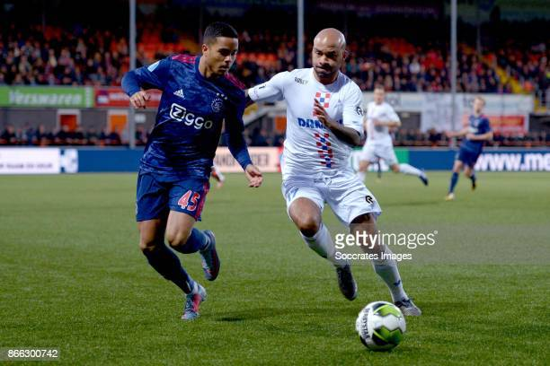 Justin Kluivert of Ajax Tony Tol of De Dijk during the Dutch KNVB Beker match between De Dijk v Ajax at the Kras Stadium on October 25 2017 in...