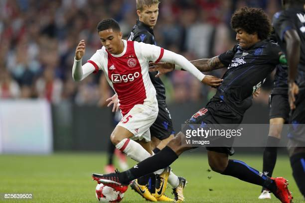 Justin Kluivert of Ajax Vincent Koziello of OCG Nice Dante of OCG Nice during the UEFA Champions League third round qualifying first leg match...