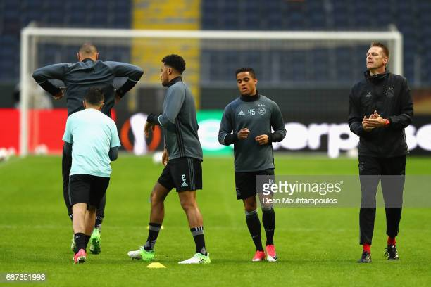 Justin Kluivert of Ajax warms up during a training session at The Friends Arena ahead of the UEFA Europa League Final between Ajax and Manchester...