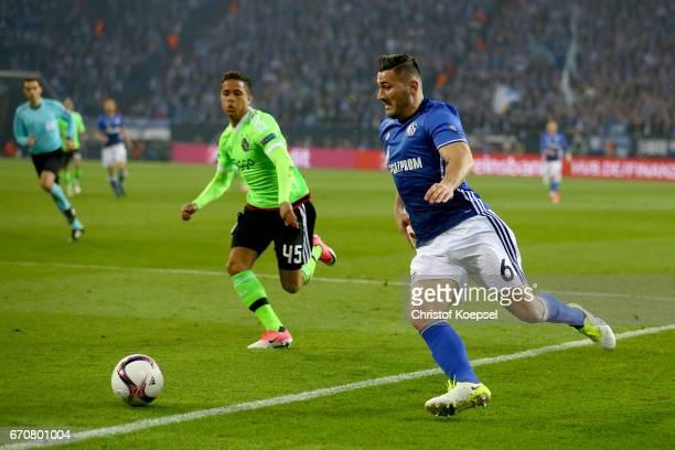 Justin Kluivert of Amsterdam challenges Sead Kolasinac of Schalke during the UEFA Europa League quarter final second leg match between FC Schalke 04...
