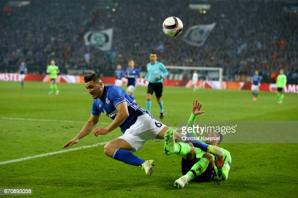 Justin Kluivert of Amsterdam challenges Sead Kolasinac of Schalke during the UEFA Europa League quarter final second leg match between FC Schalke 04...