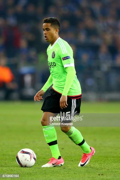 Justin Kluivert of Amsterdam runs with the ball during the UEFA Europa League quarter final second leg match between FC Schalke 04 and Ajax Amsterdam...