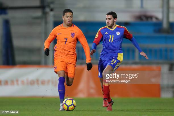 Justin Kluivert of Holland U21 Roger Nazzaro of Andorra U21 during the match between Holland U21 v Andorra U21 at the De Vijverberg on November 10...
