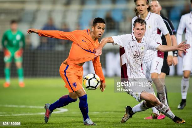 Justin Kluivert of Jong Oranje Emsis Eduards of Jong Letland during the EURO U21 2017 qualifying match between Netherlands U21 and Latvia U21 at the...