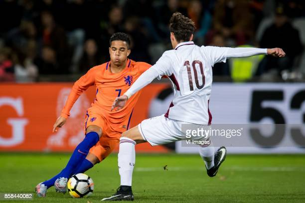 Justin Kluivert of Jong Oranje Fjordorovs Vladislavs of Jong Letland during the EURO U21 2017 qualifying match between Netherlands U21 and Latvia U21...