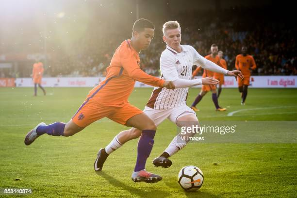 Justin Kluivert of Jong Oranje Grinbergs Janis of Jong Letland during the EURO U21 2017 qualifying match between Netherlands U21 and Latvia U21 at...