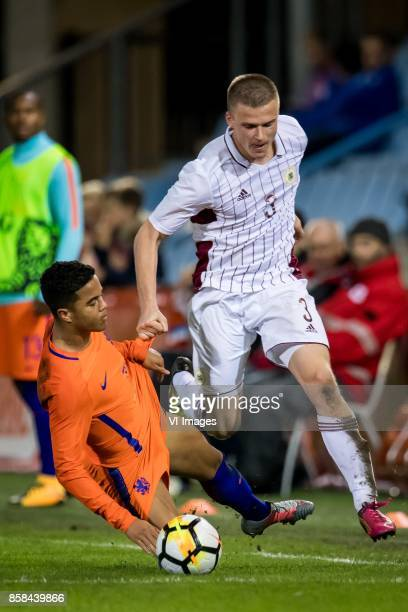 Justin Kluivert of Jong Oranje Litvinskis Viktors of Jong Letland during the EURO U21 2017 qualifying match between Netherlands U21 and Latvia U21 at...