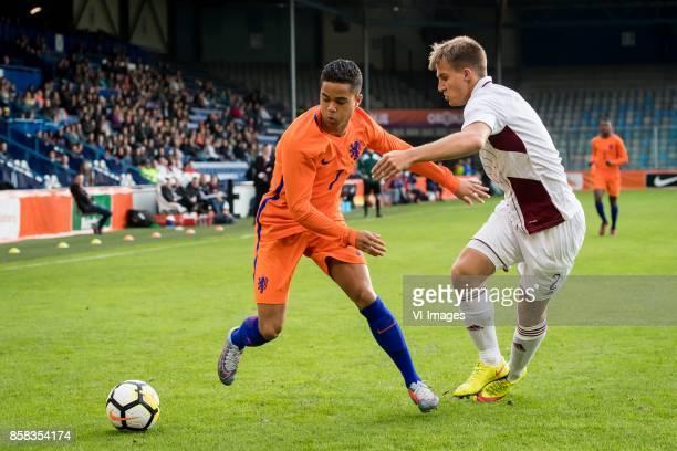 Justin Kluivert of Jong Oranje Sorokins Vladislavs of Jong Letland during the EURO U21 2017 qualifying match between Netherlands U21 and Latvia U21...