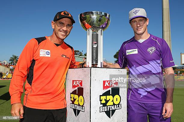 Justin Langer coach of the Scorchers and George Bailey captain of the Hurricanes pose with the trophy before the Big Bash League Final match between...