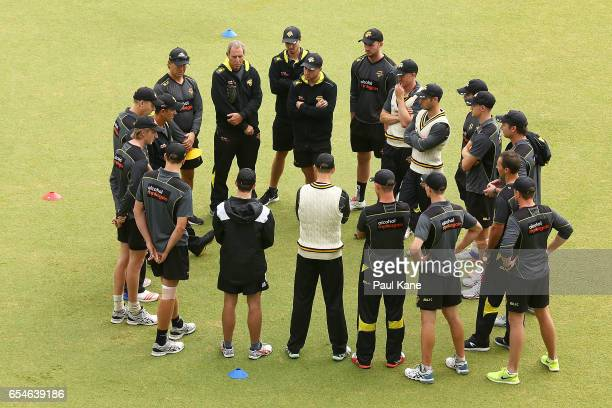 Justin Langer coach of Western Australia addresses his players before start of play on day 3 during the Sheffield Shield match between Western...