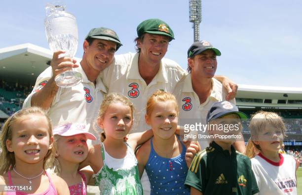 Justin Langer Glenn McGrath and Shane Warne of Australia celebrate with their children after Australia had won the 5th Test match between Australia...
