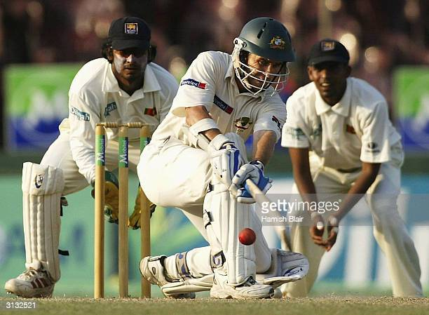 Justin Langer of Australia in action Langer has been charged with bringing the game into disrepute after dislodging a bail whilst Hashan Tillakaratne...