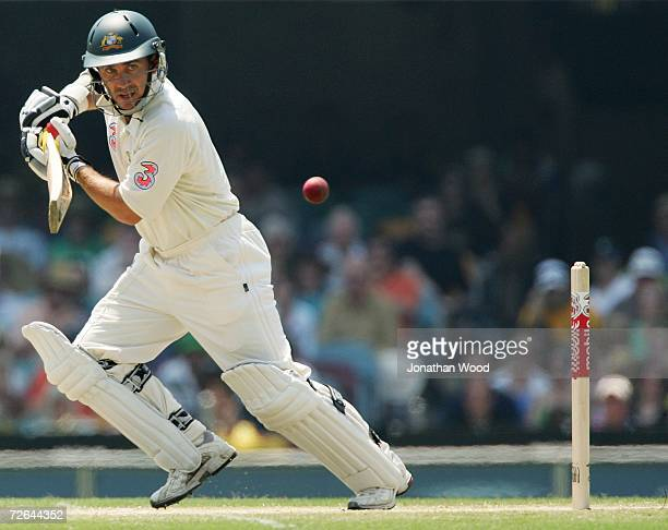 Justin Langer of Australia square drives during day four of the first Ashes Test Match between Australia and England at The Gabba on November 26 2006...