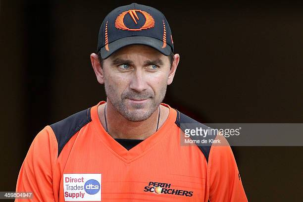Justin Langer of Perth looks on during the Big Bash League match between the Adelaide Strikers and the Perth Scorchers at Adelaide Oval on December...