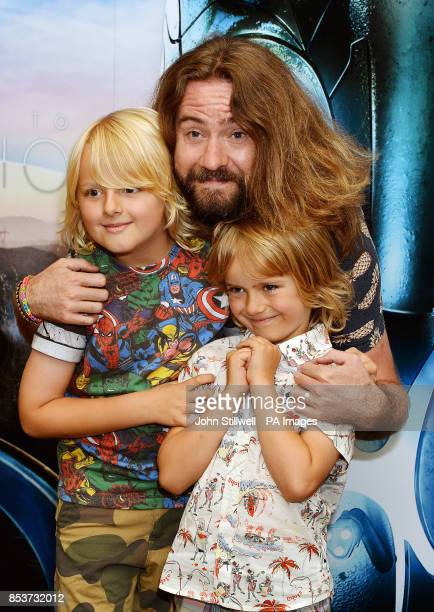 Justin Lee Collins with his sons Archie and Harvey arriving for a celebrity screening of the film Earth to Echo at the May Fair Hotel in central...