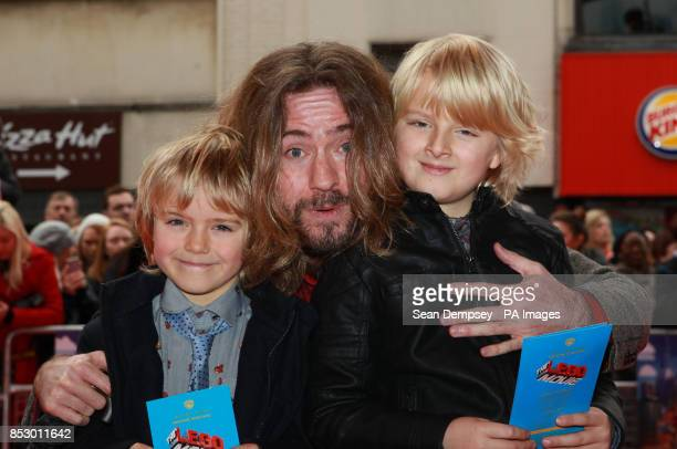 Justin Lee Collins with sons Archie and Harvey arriving at a celebrity screening of The Lego Movie at the Vue West End Leicester Square London