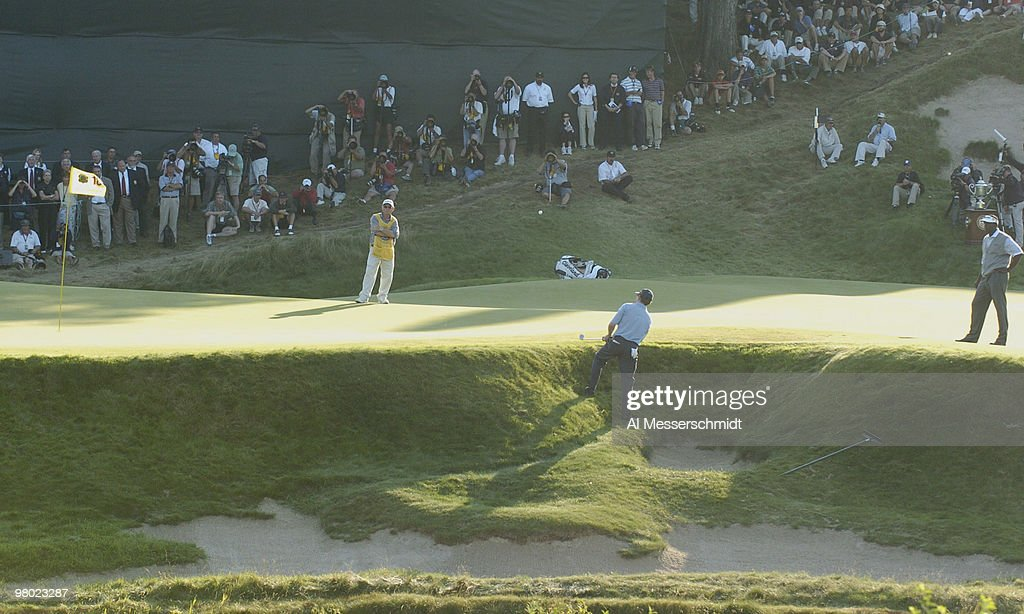 <a gi-track='captionPersonalityLinkClicked' href=/galleries/search?phrase=Justin+Leonard&family=editorial&specificpeople=194762 ng-click='$event.stopPropagation()'>Justin Leonard</a> chips from a front bunker near the 18th green during the final round at Whistling Straits, site of the 86th PGA Championship in Haven, Wisconsin August 15, 2004. Winner <a gi-track='captionPersonalityLinkClicked' href=/galleries/search?phrase=Vijay+Singh&family=editorial&specificpeople=179484 ng-click='$event.stopPropagation()'>Vijay Singh</a> watches.