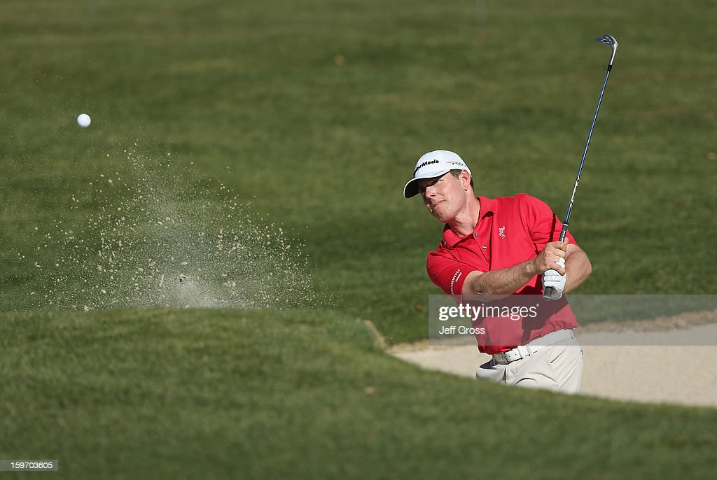 Justin Leonard hits a bunker shot to the 16th green during the second round of the Humana Challenge In Partnership With The Clinton Foundation at La Quinta Country Club on January 18, 2013 in La Quinta, California.