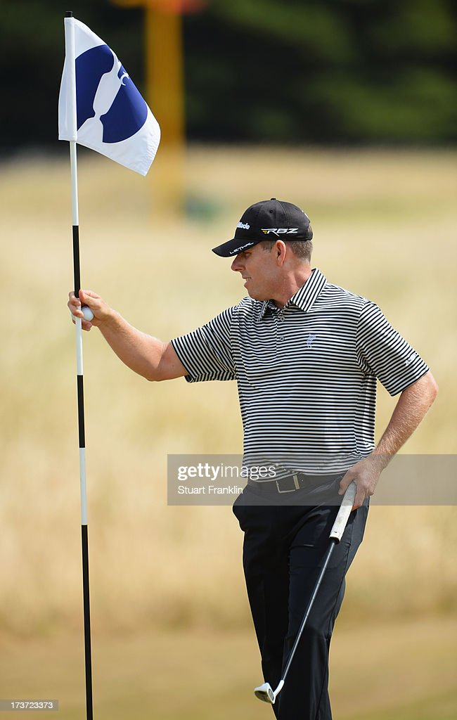 Justin Leonard of the United States tends a flag ahead of the 142nd Open Championship at Muirfield on July 17, 2013 in Gullane, Scotland.