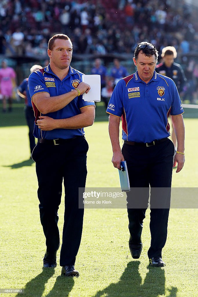 Justin Leppitsch (L) of the Lions leaves the field after the round 4 AFL game between Port Adelaide and the Brisbane Lions at Adelaide Oval on April 12, 2014 in Adelaide, Australia.