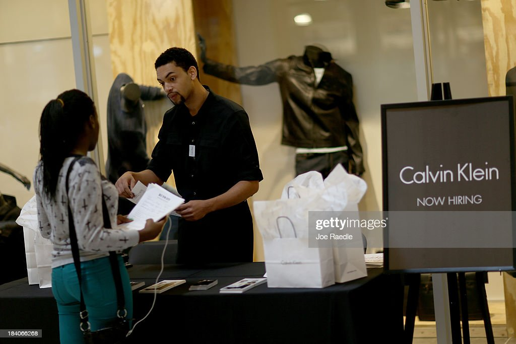 Justin Magher recruits people for work at Calvin Klein during a job fair at Sawgrass Mills on October 11, 2013 in Sunrise, Florida. As the holiday season approaches many of the roughly 50 retailers at the job fair including Banana Republic, J.Crew Factory, Victoria's Secret and Calvin Klein are starting to hire people for seasonal work as well as continuing to look for qualified full time employees.