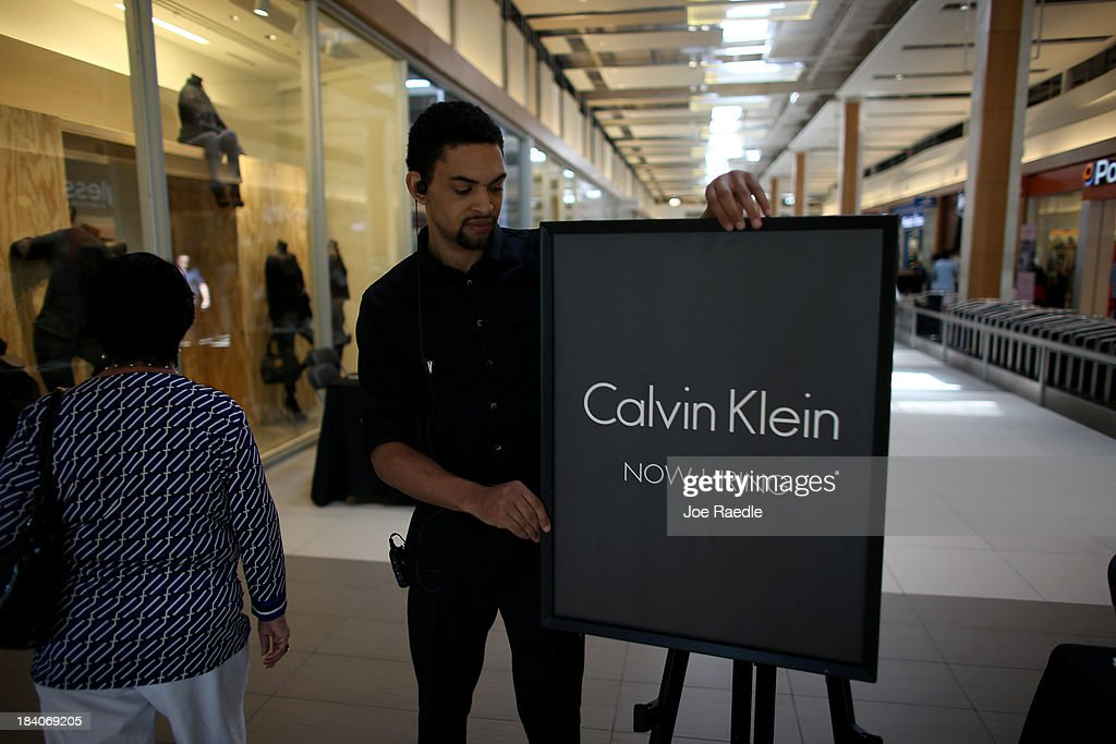 Justin Magher sets up a sign as he recruits people for work at Calvin Klein during a job fair at Sawgrass Mills on October 11, 2013 in Sunrise, Florida. As the holiday season approaches many of the roughly 50 retailers at the job fair including Banana Republic, J.Crew Factory, Victoria's Secret and Calvin Klein are starting to hire people for seasonal work as well as continuing to look for qualified full time employees.