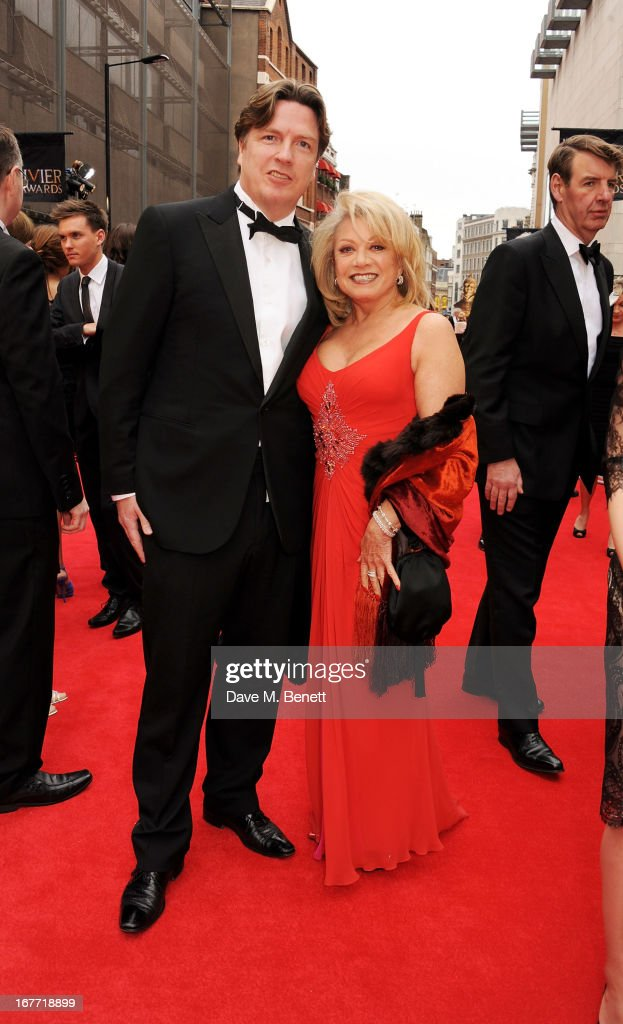 Justin Mallinson (L) and Elaine Paige arrive at The Laurence Olivier Awards 2013 at The Royal Opera House on April 28, 2013 in London, England.