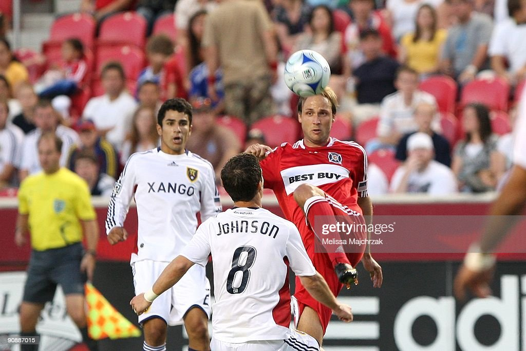 Justin Mapp of Chicago Fire goes up for the ball against Will Johnson of Real Salt Lake at Rio Tinto Stadium on September 12 2009 in Sandy Utah