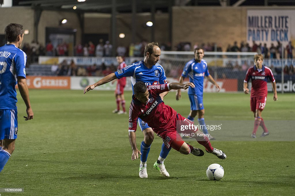 Justin Mapp of Montreal Impact trips up Alex of Chicago Fire at Toyota Park on September 15 2012 in Bridgeview Illinois The Fire defeated the Impact...