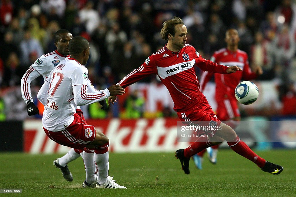 Justin Mapp of the Chicago Fire controls the ball from Jeremy Hall of the New York Red Bulls during the match at Red Bull Arena on March 27 2010 in...