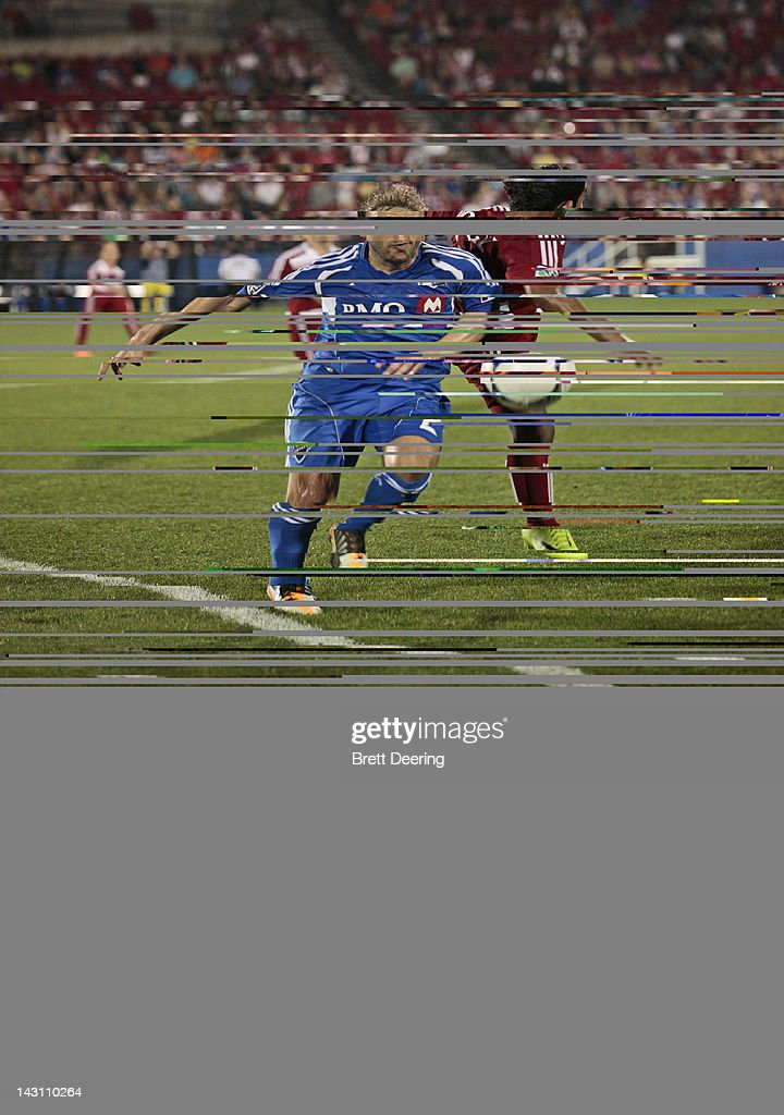 Justin Mapp of the Montreal Impact and Carlos Rodriguez of FC Dallas vie for the ball at FC Dallas Stadium on April 14 2012 in Frisco Texas Dallas...