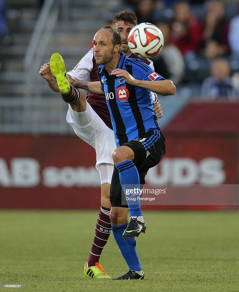 Justin Mapp #21 of the Montreal Impact and Jose Mari #6 of the Colorado Rapids battle for control of the ball at Dick's Sporting Goods Park on May 24, 2014 in Commerce City, Colorado. The Rapids defeated the Impact 4-1.