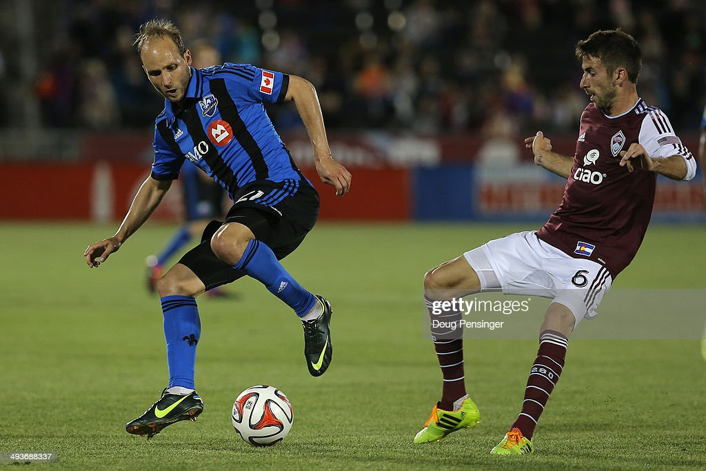 Justin Mapp of the Montreal Impact and Jose Mari of the Colorado Rapids pursue the ball at Dick's Sporting Goods Park on May 24 2014 in Commerce City...