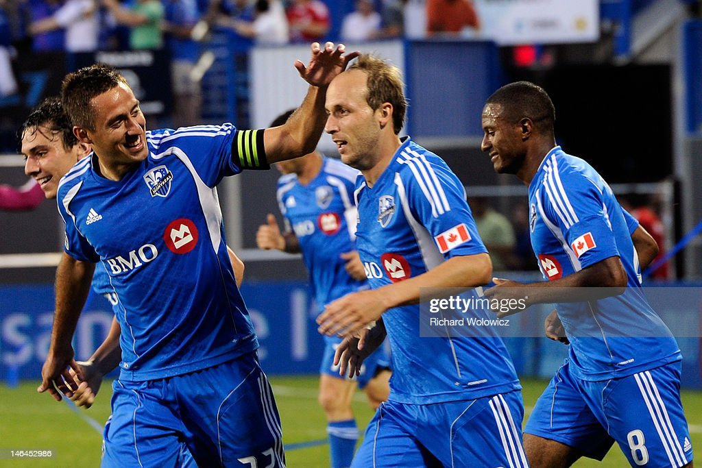Justin Mapp of the Montreal Impact celebrates his second half goal with teammate Davy Arnaud during the match against Seattle Sounders FC at the...