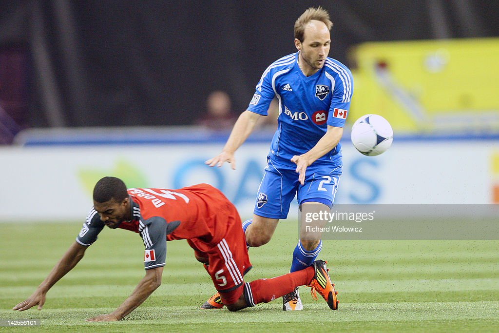 Justin Mapp of the Montreal Impact collides with Ashtone Morgan of the Toronto FC during the MLS match at the Olympic Stadium on April 7 2012 in...